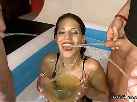 bizarre porn - Brunette drinking and swallowing urinei