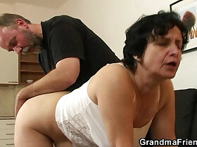 cock porn - Granny in white lingerie swallowing two cocks after pussy toying
